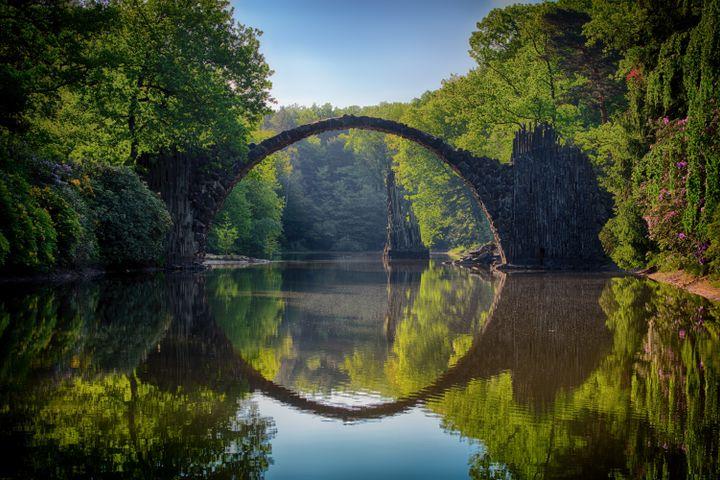 tree lake water outdoor river bridge sky arch bridge