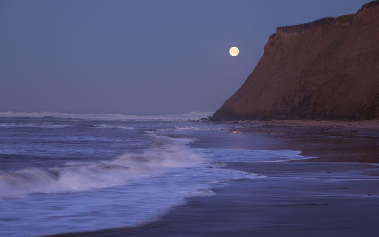 outdoor water sky nature beach ocean moon mountain