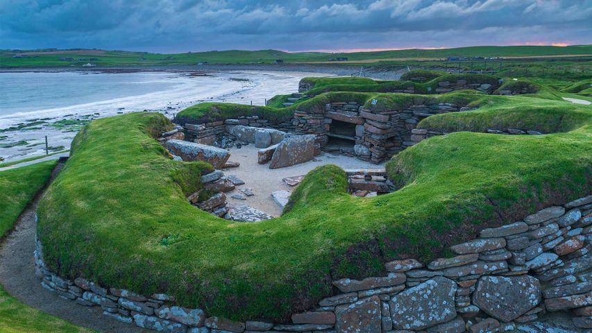 Stormy sky over Skara Brae, a Neolithic village on the Mainland, Orkney