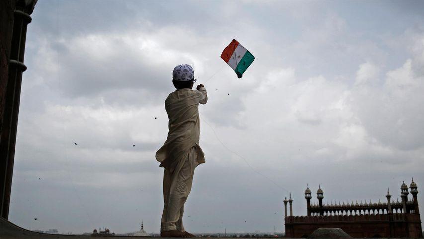 A boy flies a tricoloured kite at Jama Masjid, Delhi
