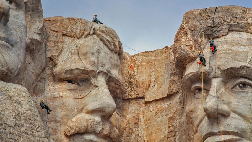 Park service employees inspecting Mount Rushmore National Memorial, South Dakota