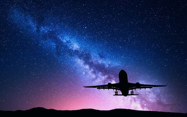 flying airplane plane sky aircraft outdoor jet astronomy