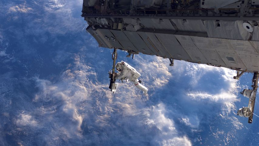 NASA astronaut works on the International Space Station during a spacewalk in 2006