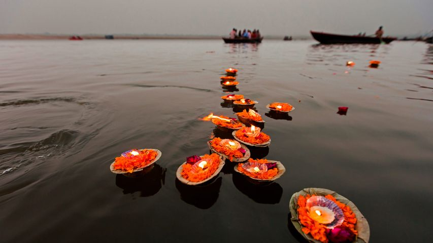 Candles floating in the Ganges, Varanasi, India