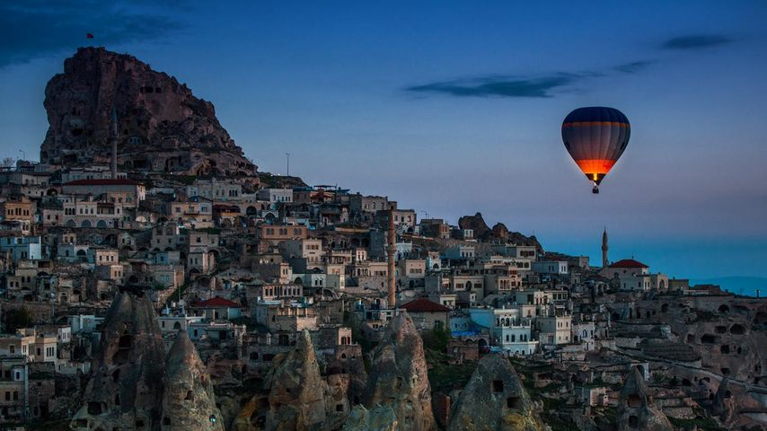 Hot-air balloon over Uçhisar in Cappadocia, Turkey