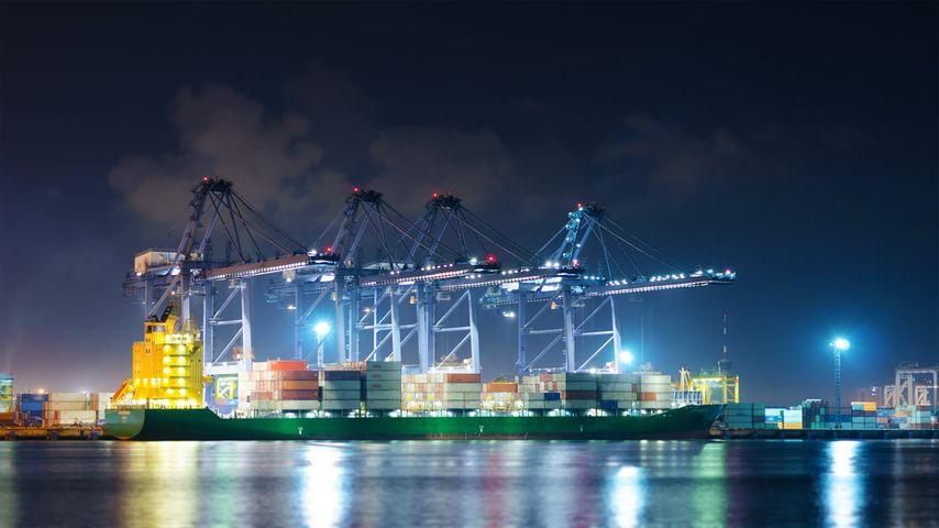 Cranes moving cargo in a Bangkok, Thailand shipping port