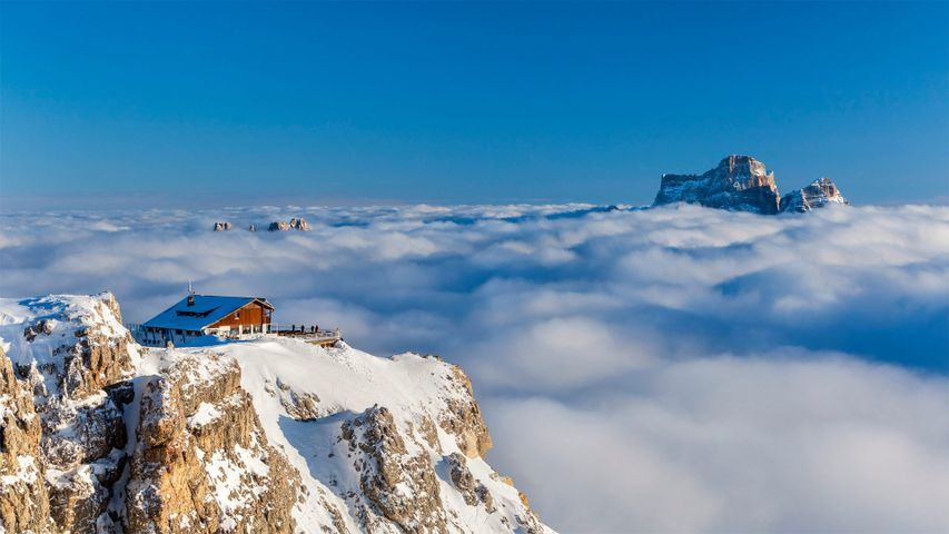 Rifugio Lagazuoi above the clouds with Monte Pelmo in the background, Dolomites, Italy