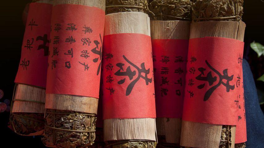 云南省普洱市江城县,简易包装的绿茶紧压茶
