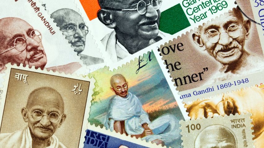 An assortment of postage stamps with images of Mahatma Gandhi