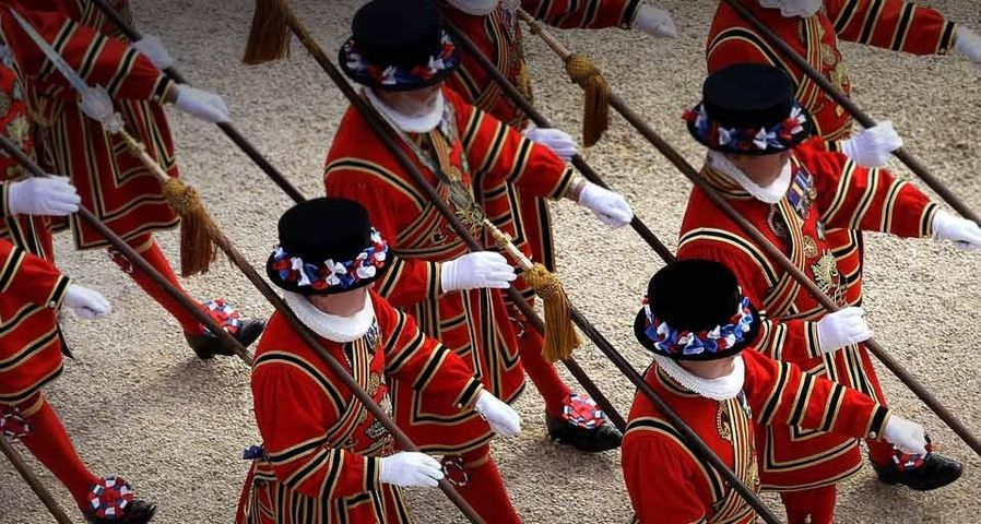 The Queen's Body Guard of the Yeoman of the Guard march in the gardens of Buckingham Palace in London, England