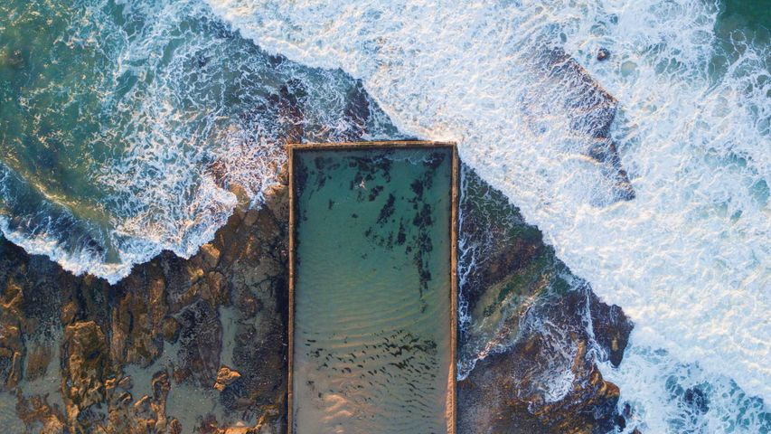 Aerial view of Cronulla rock pool with incoming waves, New South Wales