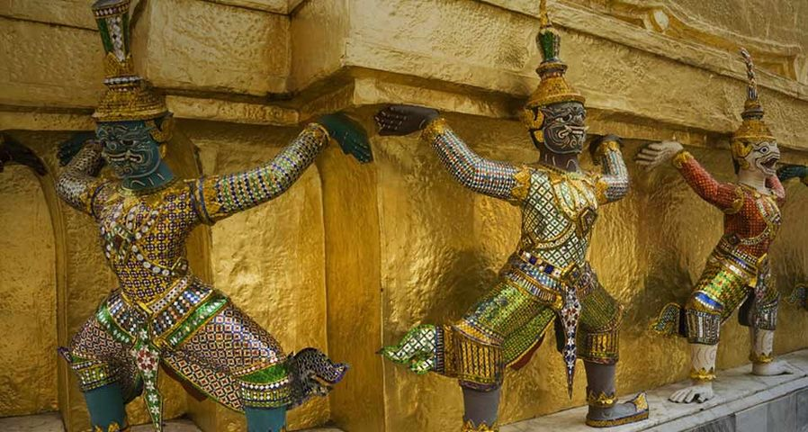 Mythical creatures guarding the golden chedi at the Grand Palace, Bangkok, Thailand