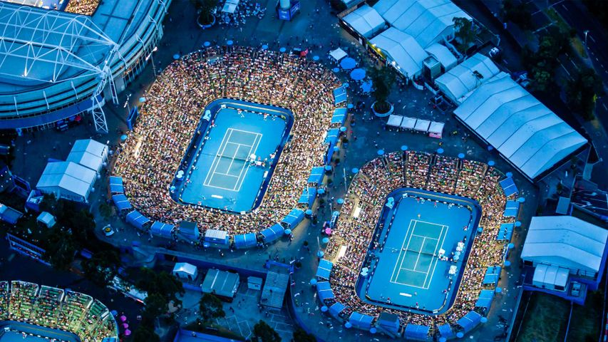 Dusk aerial view of Rod Laver Arena at the Australian Open tennis tournament