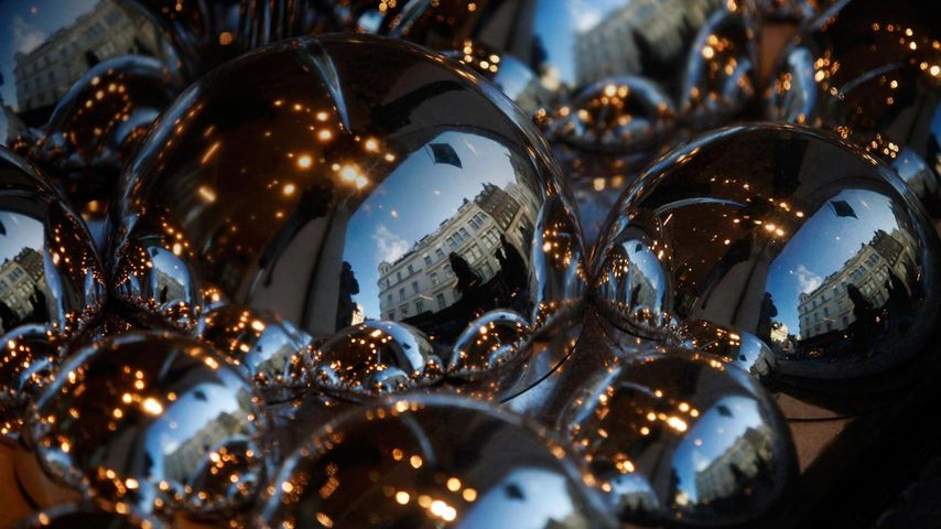 Luxury stores reflected in the Christmas window display of the Fenwick's, London