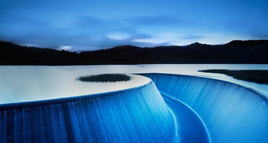 Overflow from Lower Nihotupu Reservoir near Auckland, New Zealand
