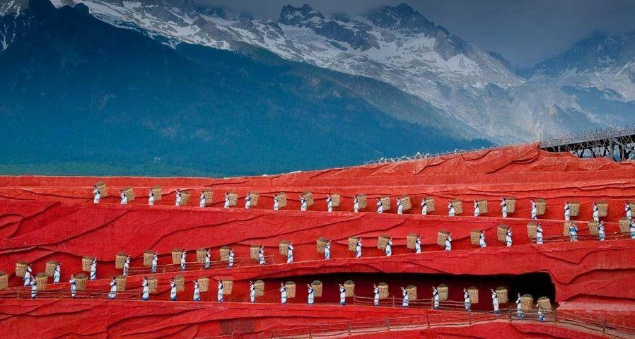 Folk dance performance in front of Jade Dragon Snow Mountain in Lijiang, Yunnan, China