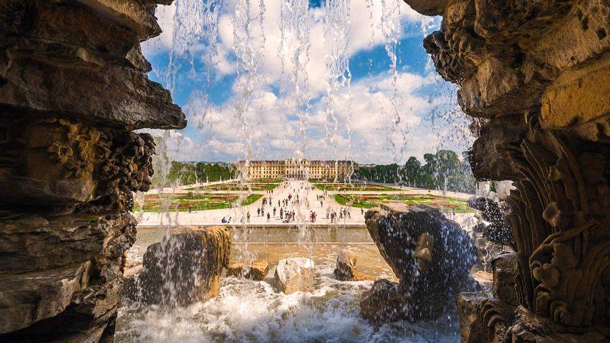 Schönbrunn Palace photographed from behind Neptune Fountain in Vienna, Austria
