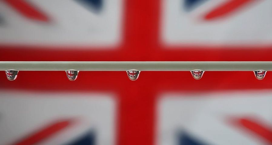 Raindrops reflected against a Union Jack flag