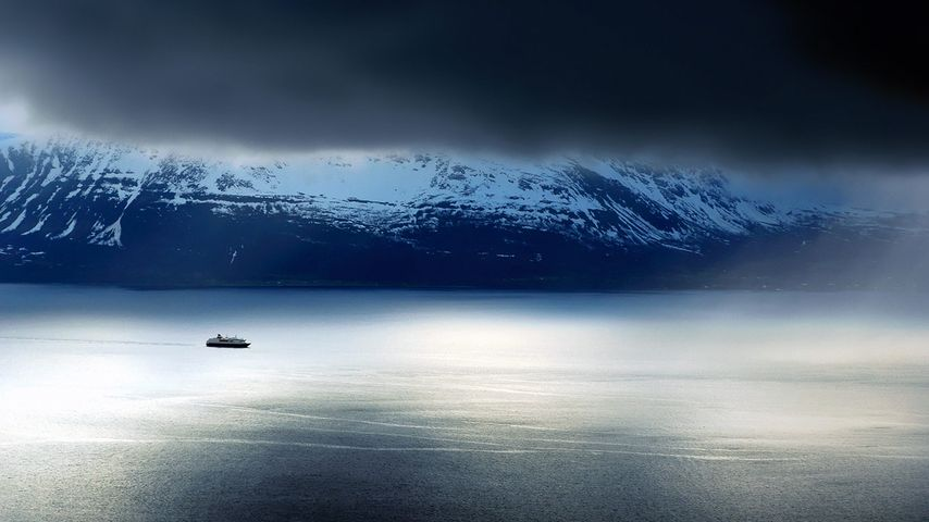 A ferry passes the Lyngen Alps in Norway