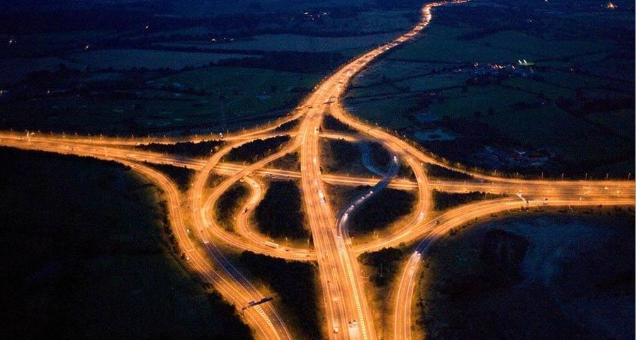 Junction of the M25 and M11 motorways at night, Essex, England