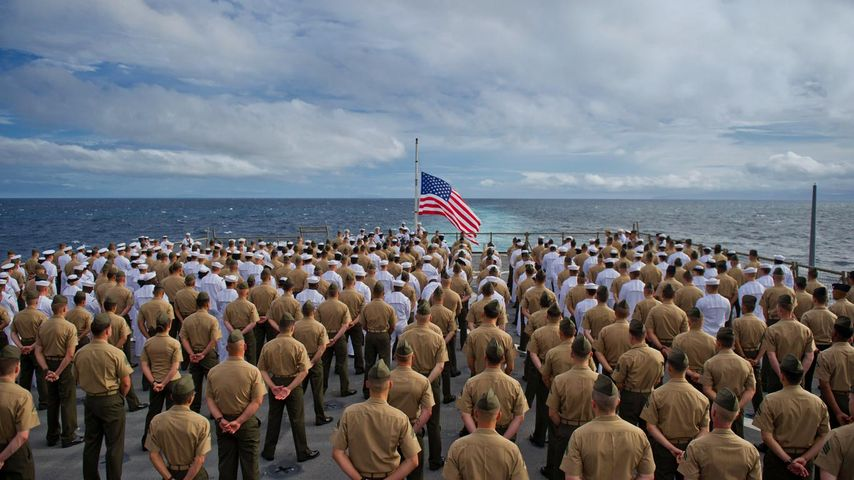Marines and sailors aboard the USS Pearl Harbor dock landing ship during the 2011 ceremony commemorating the 70th anniversary of the attack on Pearl Harbor