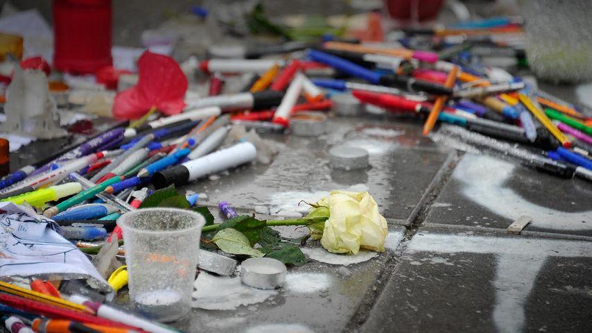 Tributes of candles, pens and flowers at Place de la Republique, Paris, France