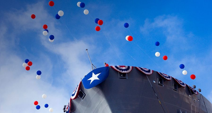 USNS Washington Chambers (T-AKE 11) decorated for christening and launch, San Diego, California