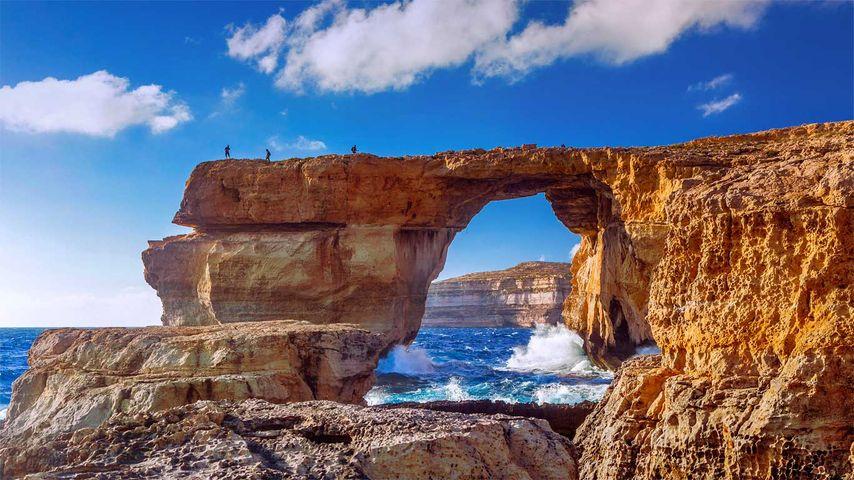 The Azure Window natural stone arch near Dwejra Beach, Gozo, Malta