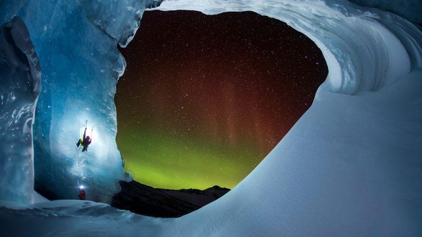 Climbing Athabasca Glacier in Jasper National Park, Alberta, Canada as the Aurora Borealis glows