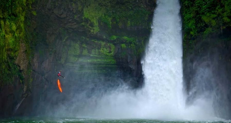 A man rappels down a huge cliff next to a waterfall on the Alseseca River in the state of Veracruz, Mexico