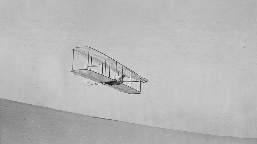 Wilbur Wright gliding down Big Kill Devil Hill in Kitty Hawk, North Carolina