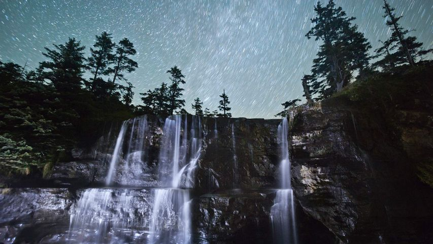 Tsusiat Falls at night, spilling onto the beach along the West Coast Trail, B.C.