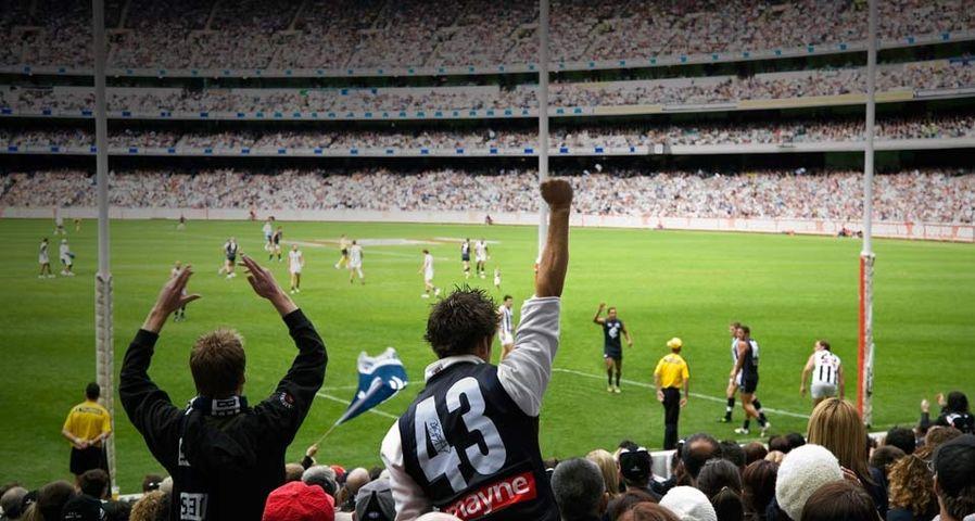 Supporters at AFL game, Melbourne Cricket Ground, Victoria, Australia