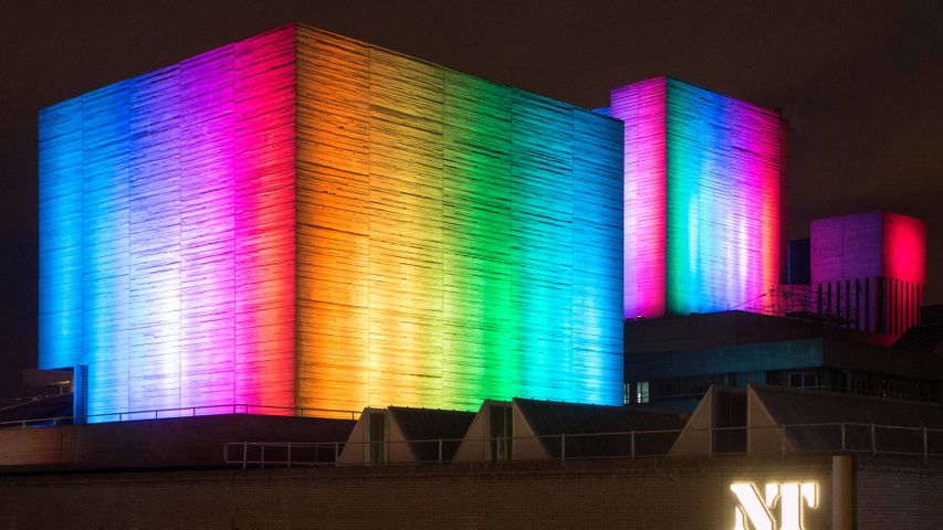 The National Theatre lit up in rainbow colours, London