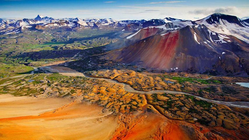 Mineral heavy peaks, Spectrum Range, Mount Edziza Provincial Park, British Columbia, Canada