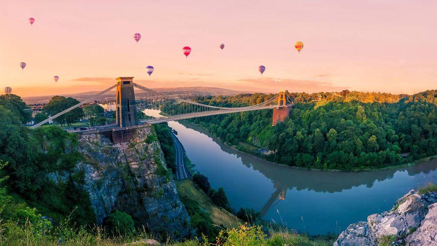Hot air balloons over Clifton Suspension Bridge at sunrise, Bristol