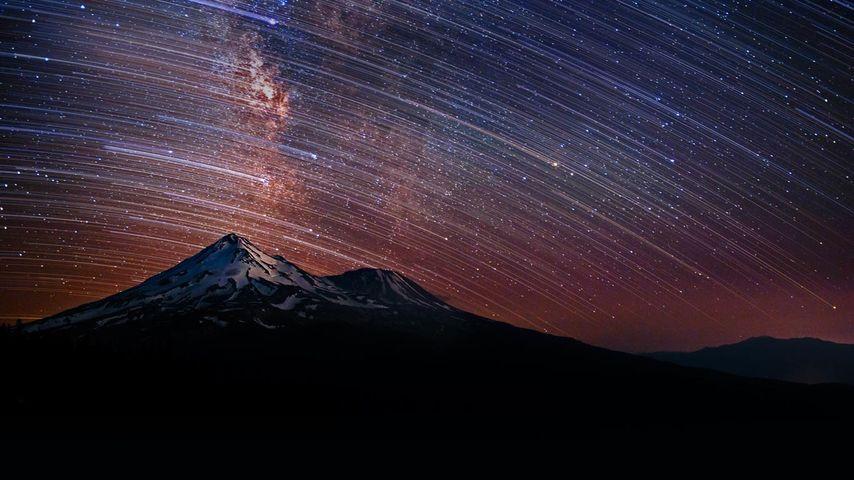 Star trails over Mount Shasta in California