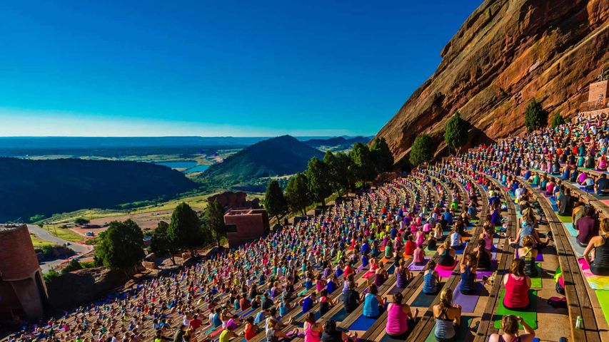Yoga practitioners at Red Rocks Amphitheatre in Colorado