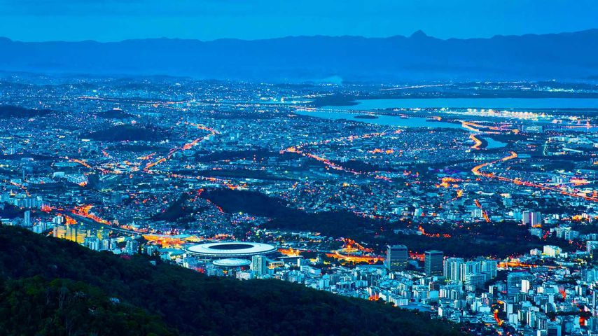 Rio de Janeiro including Maracanã Stadium illuminated at night, Brazil