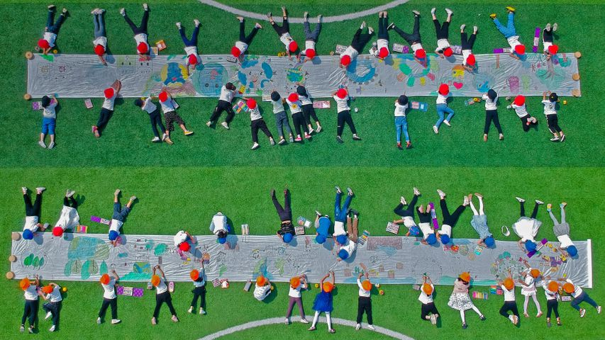 Aerial view of kindergarteners drawing on a canvas in Nantong, in the Jiangsu province of China