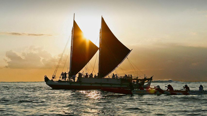 The Hōkūle'a, a traditional Hawaiian voyaging canoe, departs for a 3-year voyage from Honolulu, Hawaii, on May 17, 2014