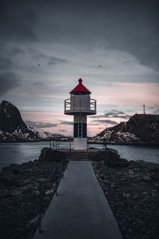 outdoor sky lighthouse landscape cloud tower water sandy