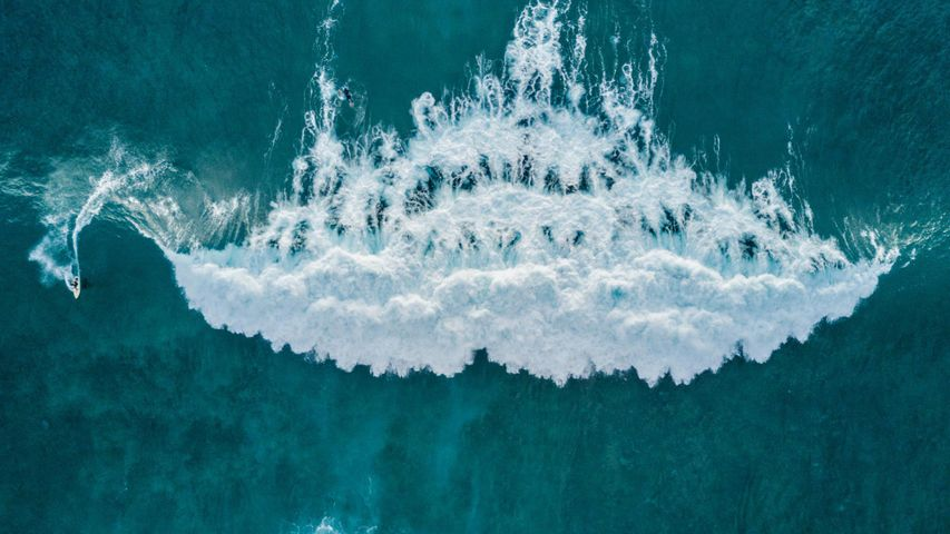 Aerial view of a surfer catching a wave, Tenerife, Canary Islands, Spain
