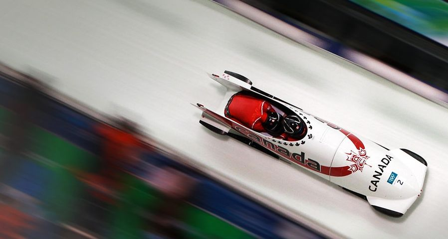 Kaillie Humphries and Heather Moyse of Canada compete in Canada 1 during the Women's Bobsleigh race at the 2010 Vancouver Winter Olympics on February 23, 2010