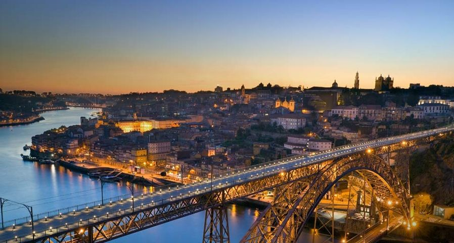 The Dom Luis I bridge and city of Porto, Portugal, at sunset