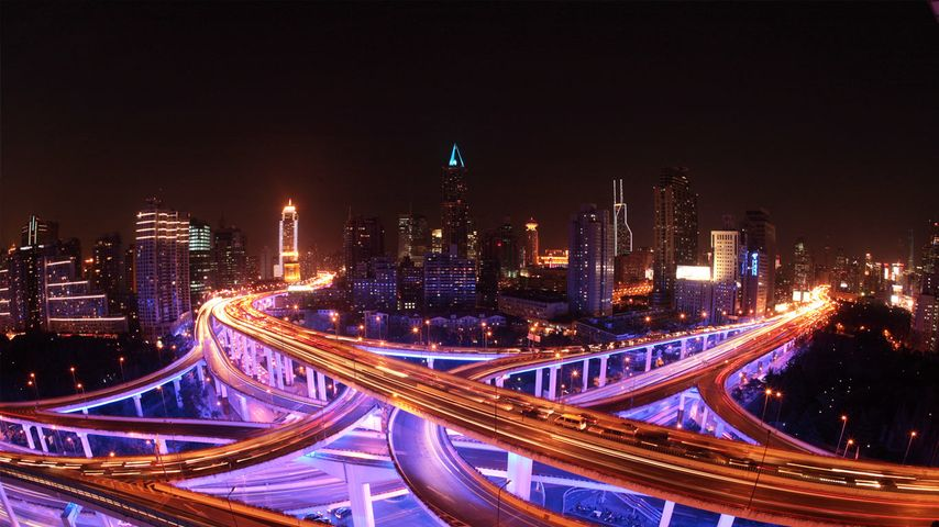 Shanghai's roadways and skyline lit up at night