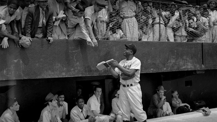 Jackie Robinson signs autographs at spring training in Ciudad Trujillo, now Santo Domingo, Dominican Republic, on March 6, 1948