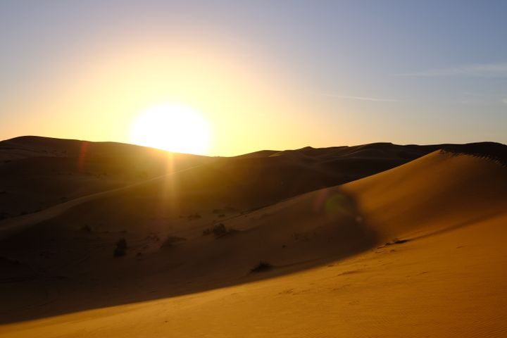 sky outdoor desert sunset nature aeolian landform sand sun