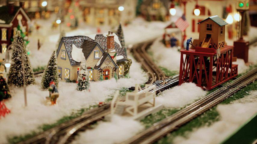 Model train set amidst a winter scene