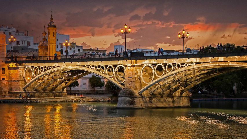 Seville, Spain's Guadalquivir River and Triana Bridge for the 500th anniversary of Magellan's departure